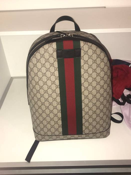 Gucci. GG supreme backpack with web d830ee29e1a40