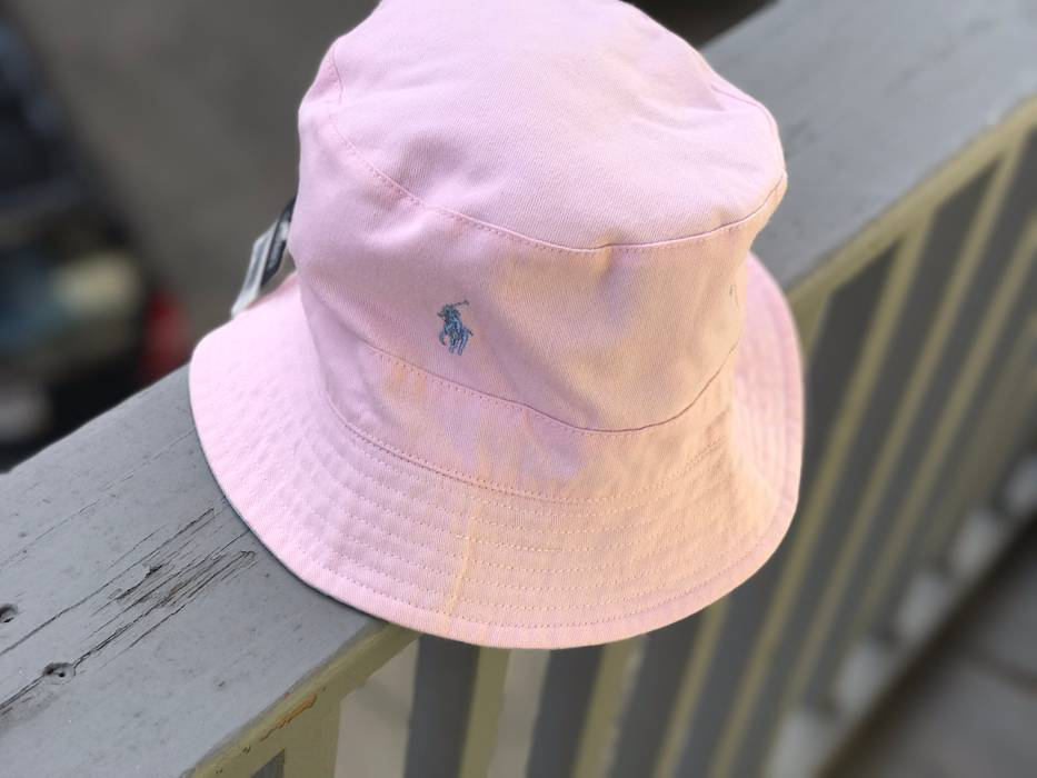 59c0a2a3c65 Polo Ralph Lauren. Reversible Pink And Baby Blue Polo Ralph Lauren Bucket  Hat
