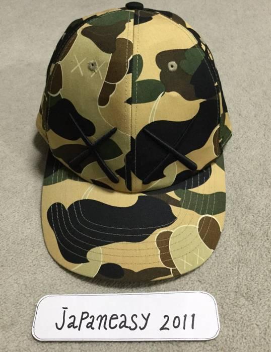 Bape BAPE KAWS 1ST CAMO BASEBALL HAT CAP YELLOW Size one size - Hats ... 80bf8b2afb9
