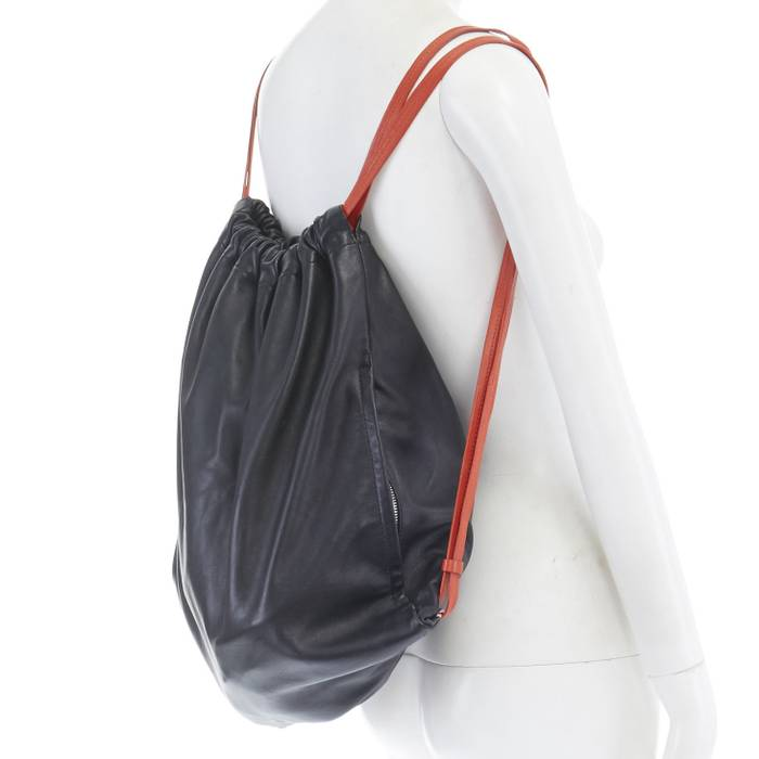 Alexander Wang. ALEXANDER WANG Walle black leather red strap drawstring gym backpack  bag. Size  ONE SIZE cdb31d2746369