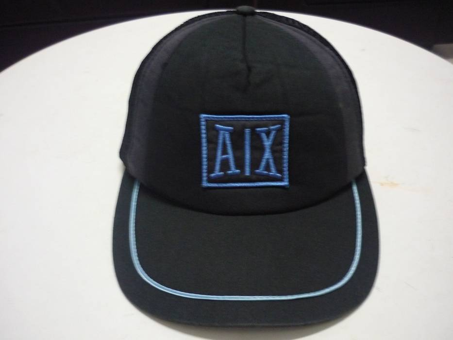 Armani Exchange. AX Armani Exchange Embroidered Logo Spellout Trucker Cap 75cde416d056