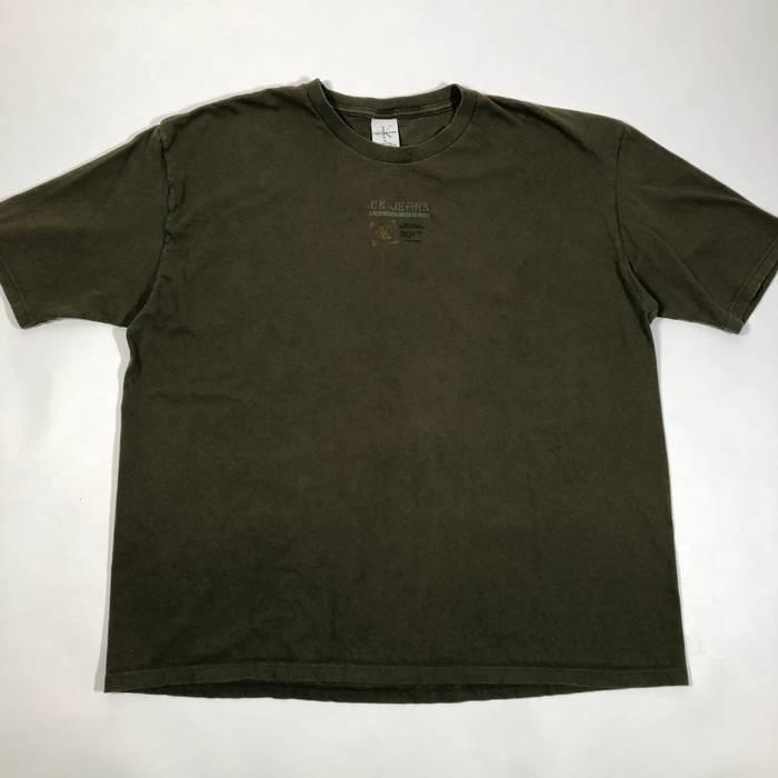 f834de6d Calvin Klein Vintage 90's Calvin Klein military green graphic tee / Men's  boxy fit Size US