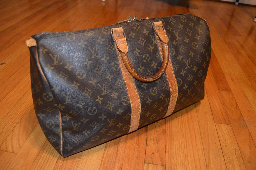 Louis Vuitton. Louis Vuitton Keepall 45 travel duffle bag. Size  ONE SIZE d542a5a2beb54