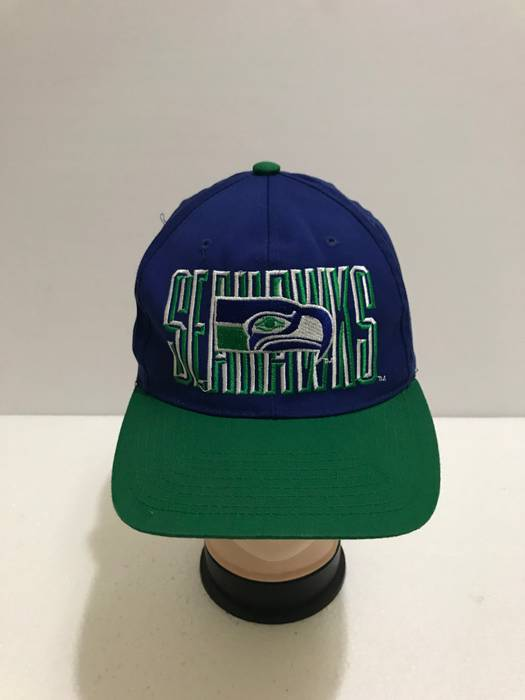dadbbc85364 Nfl Vintage 90s SEATTLE SEAHAWKS Big Logo Spell Out Embroidered Baseball Cap  Two Tone Official Licensed