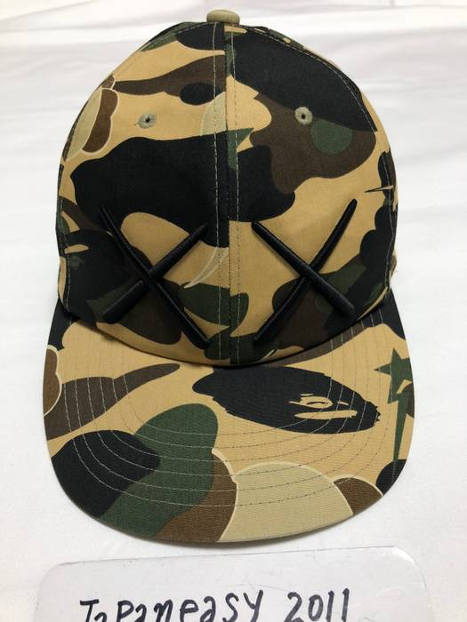 Bape KAWS 1ST CAMO BASEBALL HAT CAP Size one size - Hats for Sale ... 65277a869a5