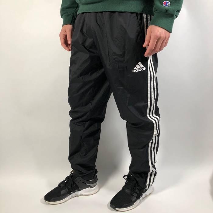1cd6d85b296f4 Adidas. Vintage 00 s y2k Adidas black full-striped nylon track pants. Size  US  32   EU 48