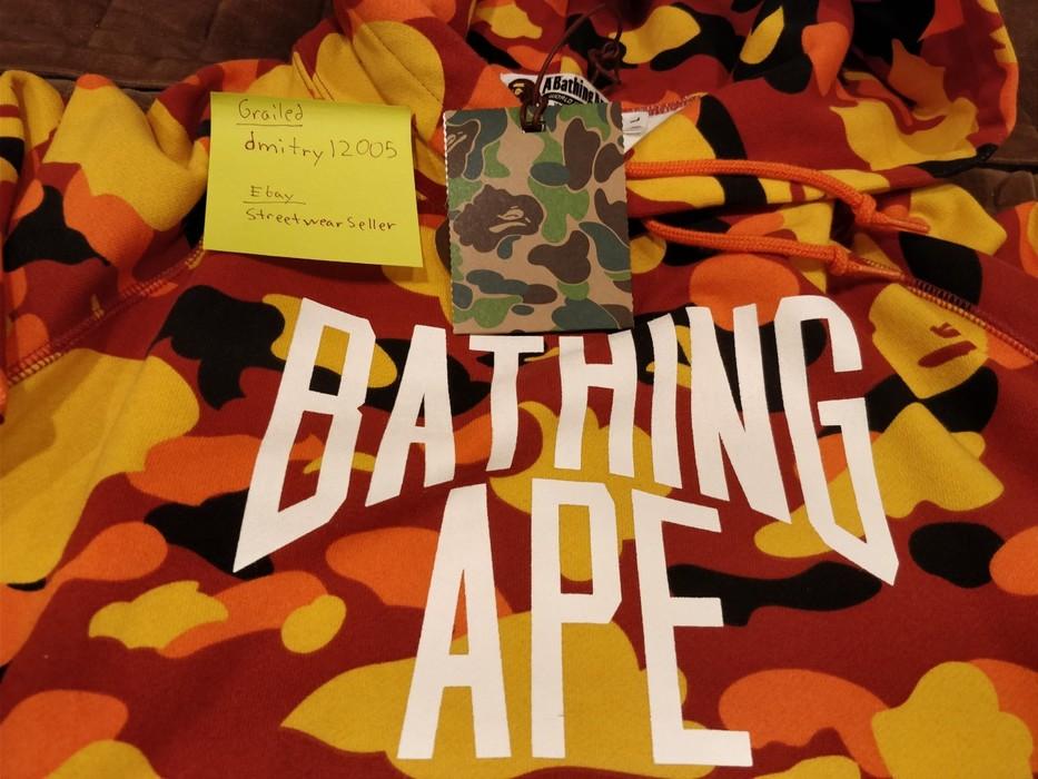 866de9b64f91 Bape Bape 1ST CAMO NYC LOGO PULLOVER HOODIE A Bathing Ape Orange Camo Size  Large Size
