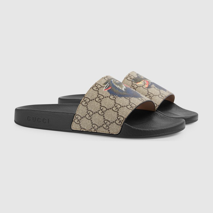 3f6fcf661def Gucci GG Supreme slide with wolf Size 10 - Slip Ons for Sale - Grailed