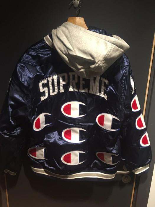 030b258c49b9 Slide 1 of 2. Supreme Supreme X Champion Hooded Satin Varsity Jacket - Navy  Size US M   EU 48
