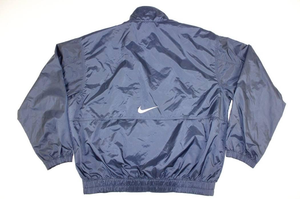 546fc0892ecd Nike Vintage 90s Large Nike Big Logo Full Zip Windbreaker Jacket Blue Size  US L