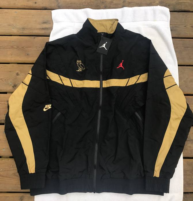 73094211e5c8 Jordan Brand LAST DROP. OVO x Air Jordan Flight Retro 8 Track Jacket Black  Gold
