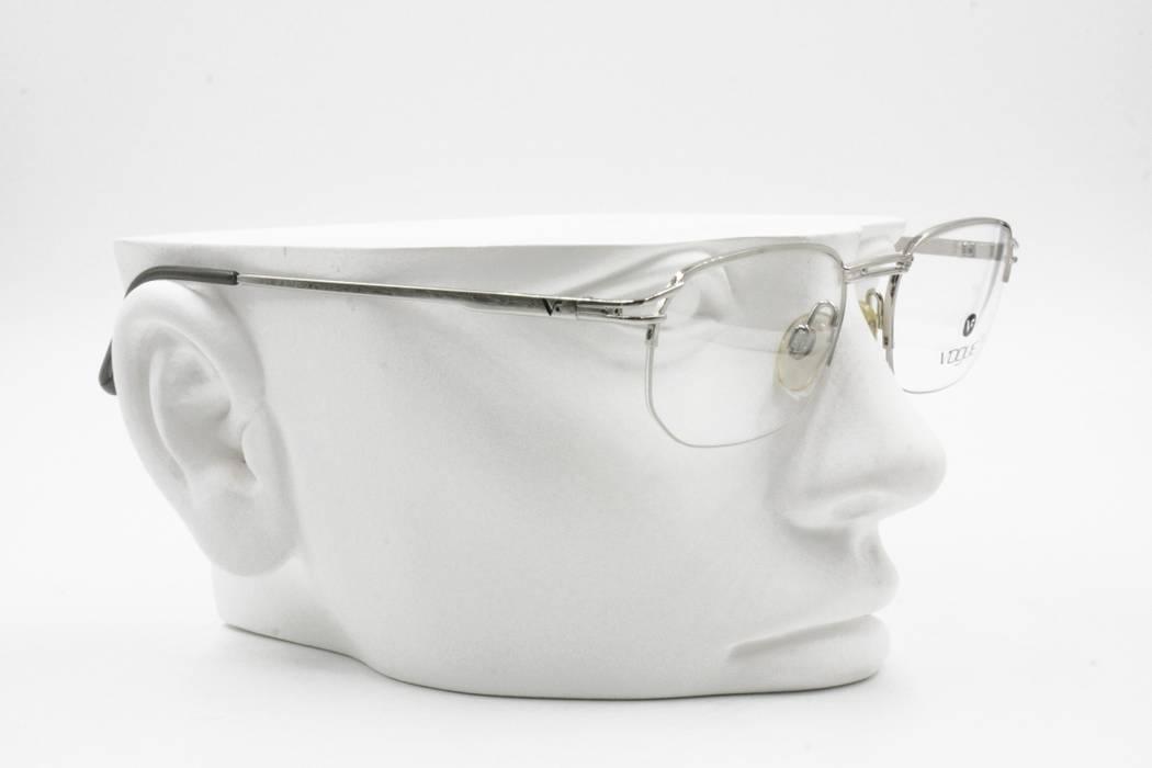 d5de3f4c352 Vogue Vogue VO3113 vintage eyeglass frame half rimmed wired