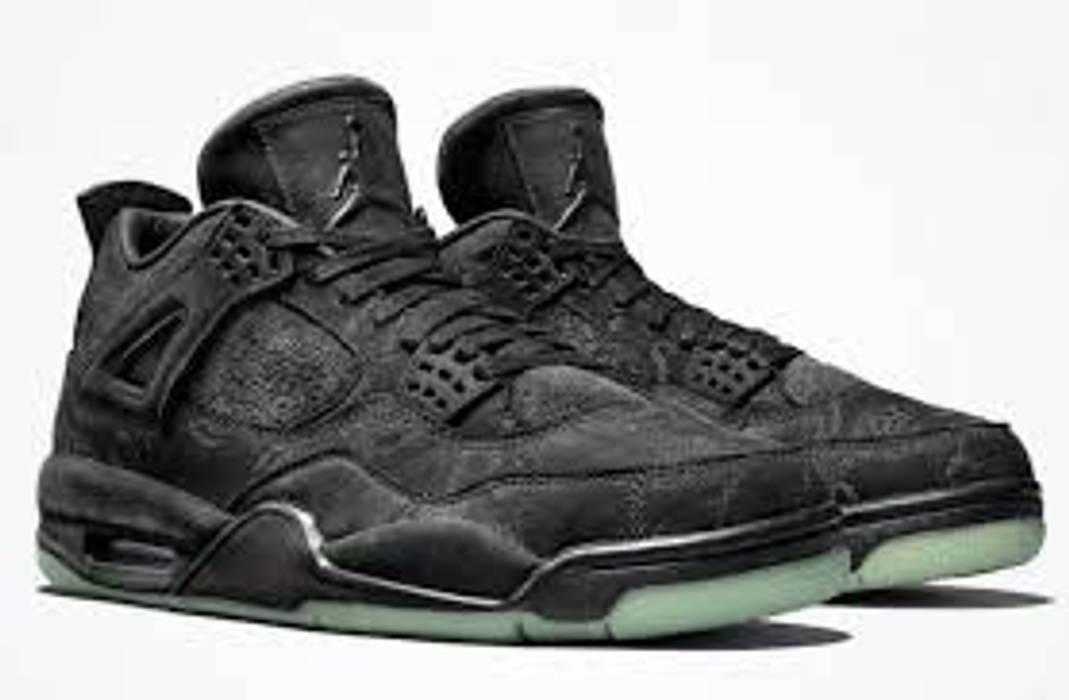 2a14ae6f229003 Jordan Brand KAWS x Air Jordan 4 Black Size 9.5 - Hi-Top Sneakers ...