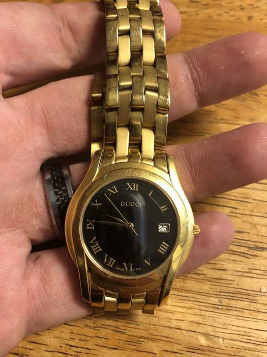 b7ea5b930e4 Gucci    250 AS IS   Vintage Gold and Black Gucci watch Size one ...