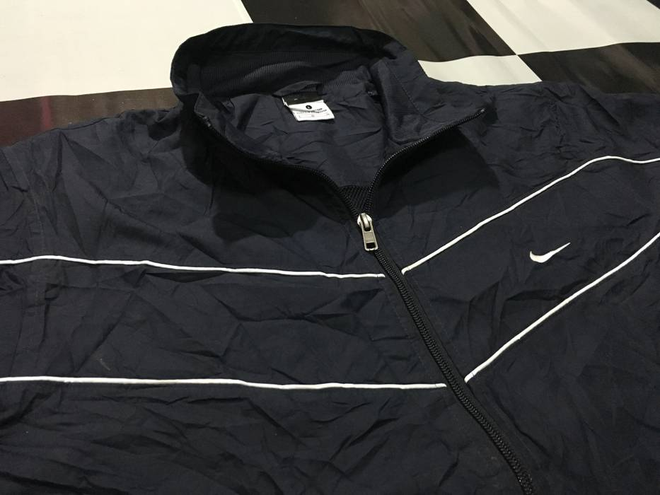 bc69a0a6ec2a Nike × Vintage. Nike jacket windbreaker Nike swoosh logo embroidered  diagonal line Black Good condition. Size  US L   EU 52-54 ...