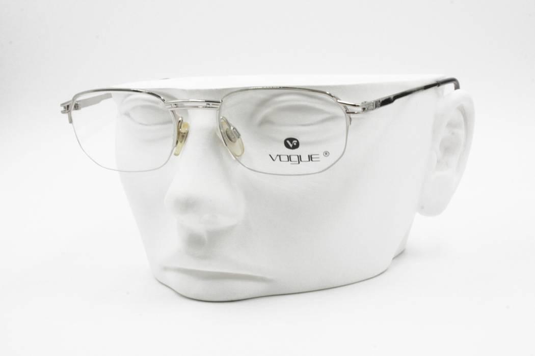 a33e95b7677 Vogue. Vogue VO3113 vintage eyeglass frame half rimmed wired