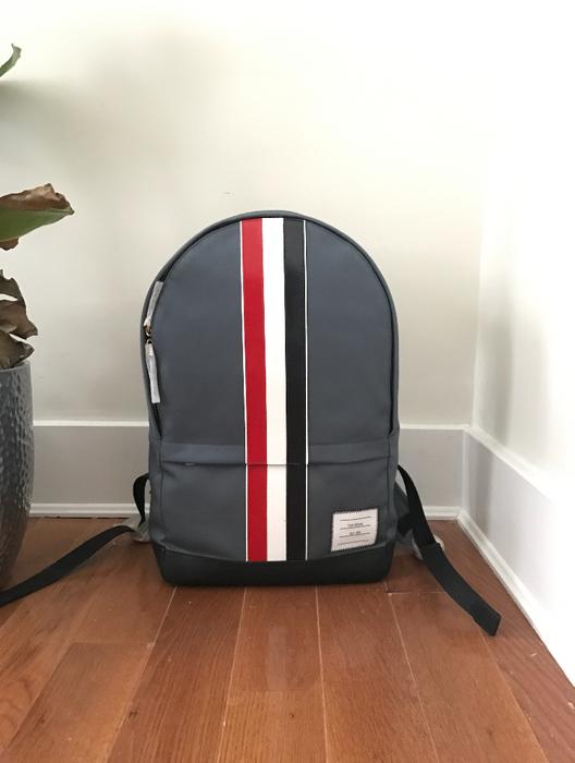 bfed1a4cc6 Thom Browne. Thom Browne Grey Backpack w  Leather Stripe