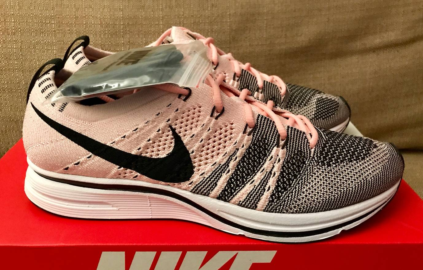 bd3905574d1a ... real nike 2017 nike flyknit trainer sunset tint black white size us 7  eu 31c4f 3806d