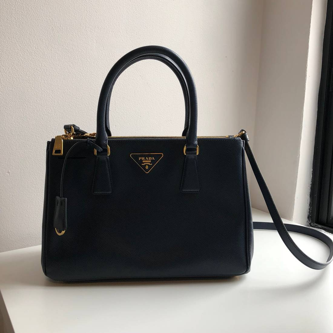 39bdf6ed1f81 ... best price prada prada saffiano tote bag in dark navy baltico size one  size 98cb3 1664a