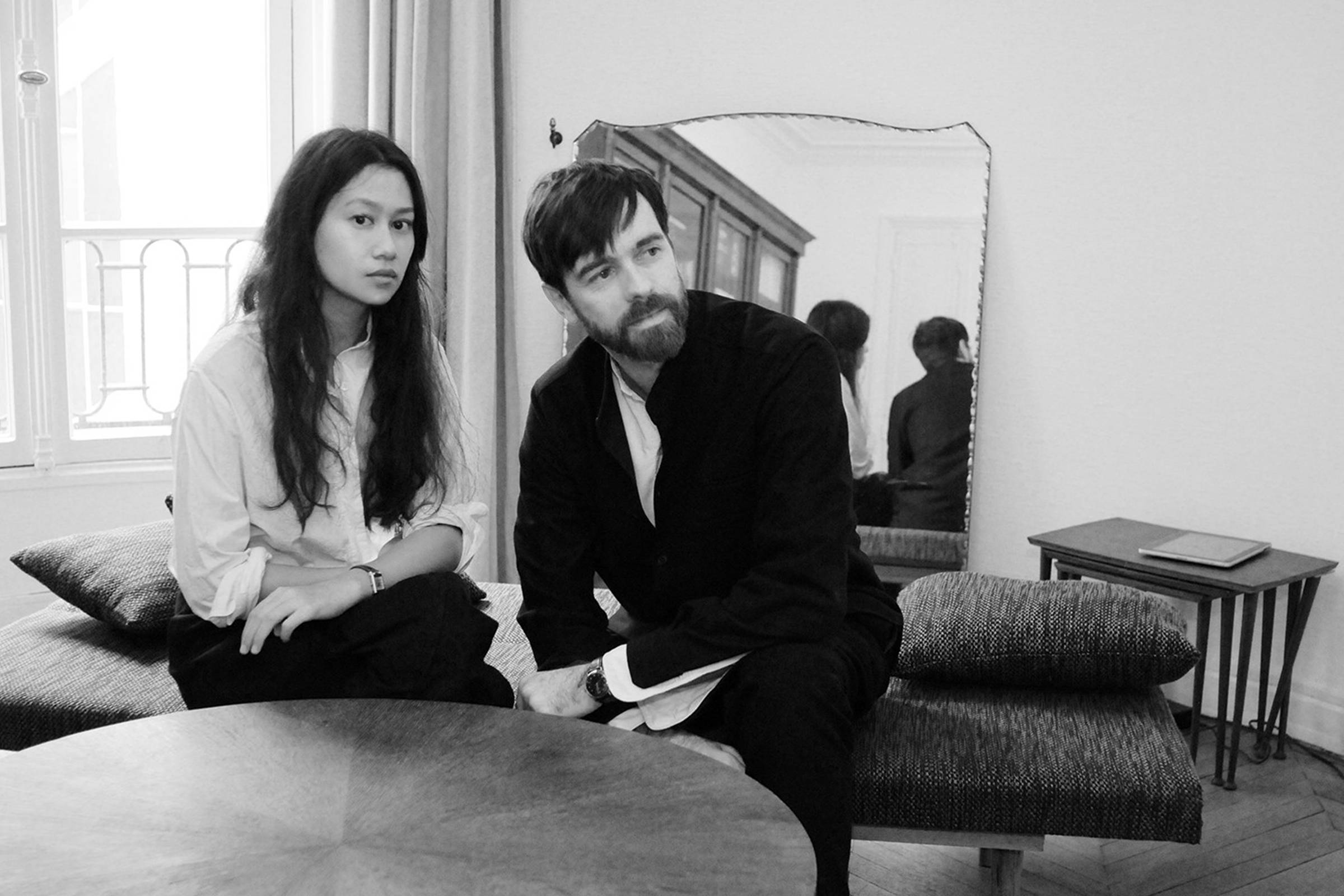 Christophe Lemaire with partner Sarah-Linh Tran