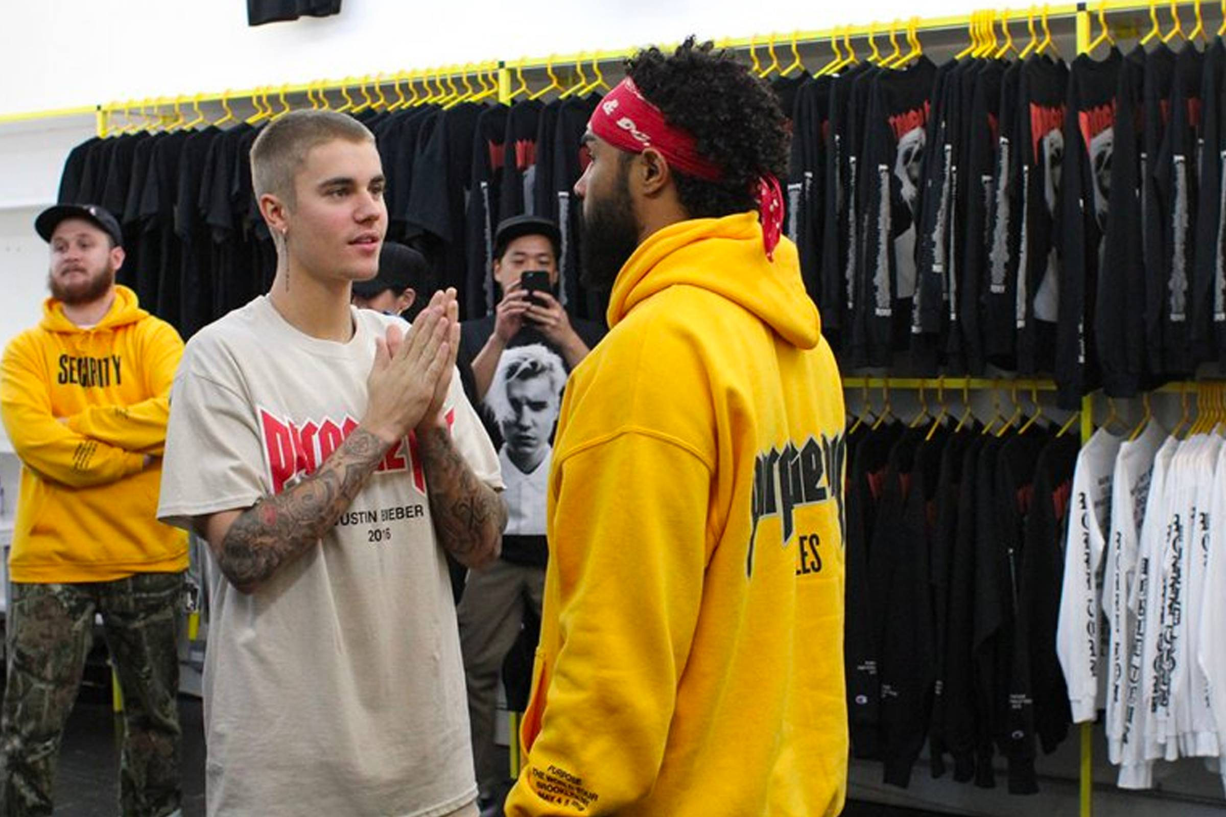 """Justin Bieber and Jerry Lorenzo (right) at a """"Purpose"""" tour merch event at VFILES in downtown New York City in 2016"""
