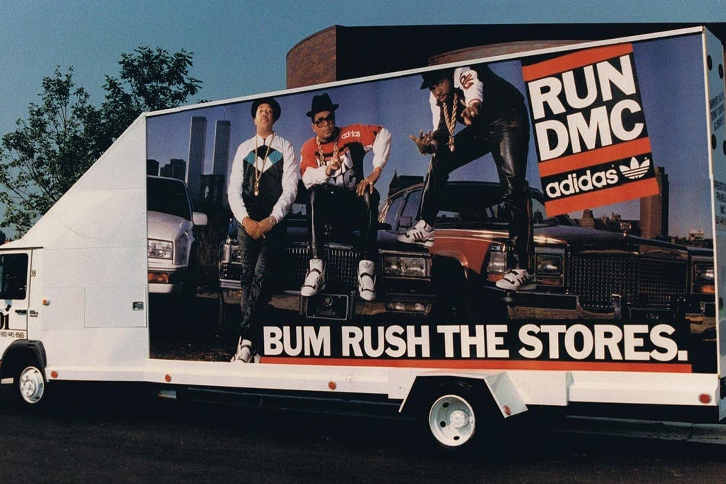 A Run-DMC adidas ad on the side of a truck