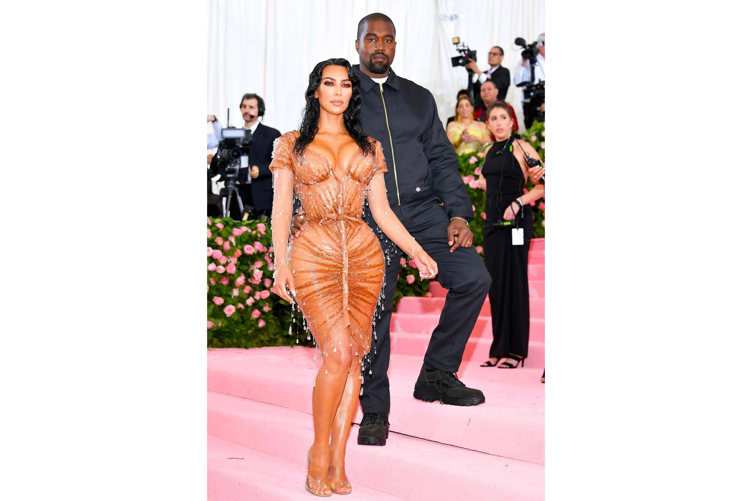 Kanye West (in Dickies) and Kim Kardashian (in Thierry Mugler)
