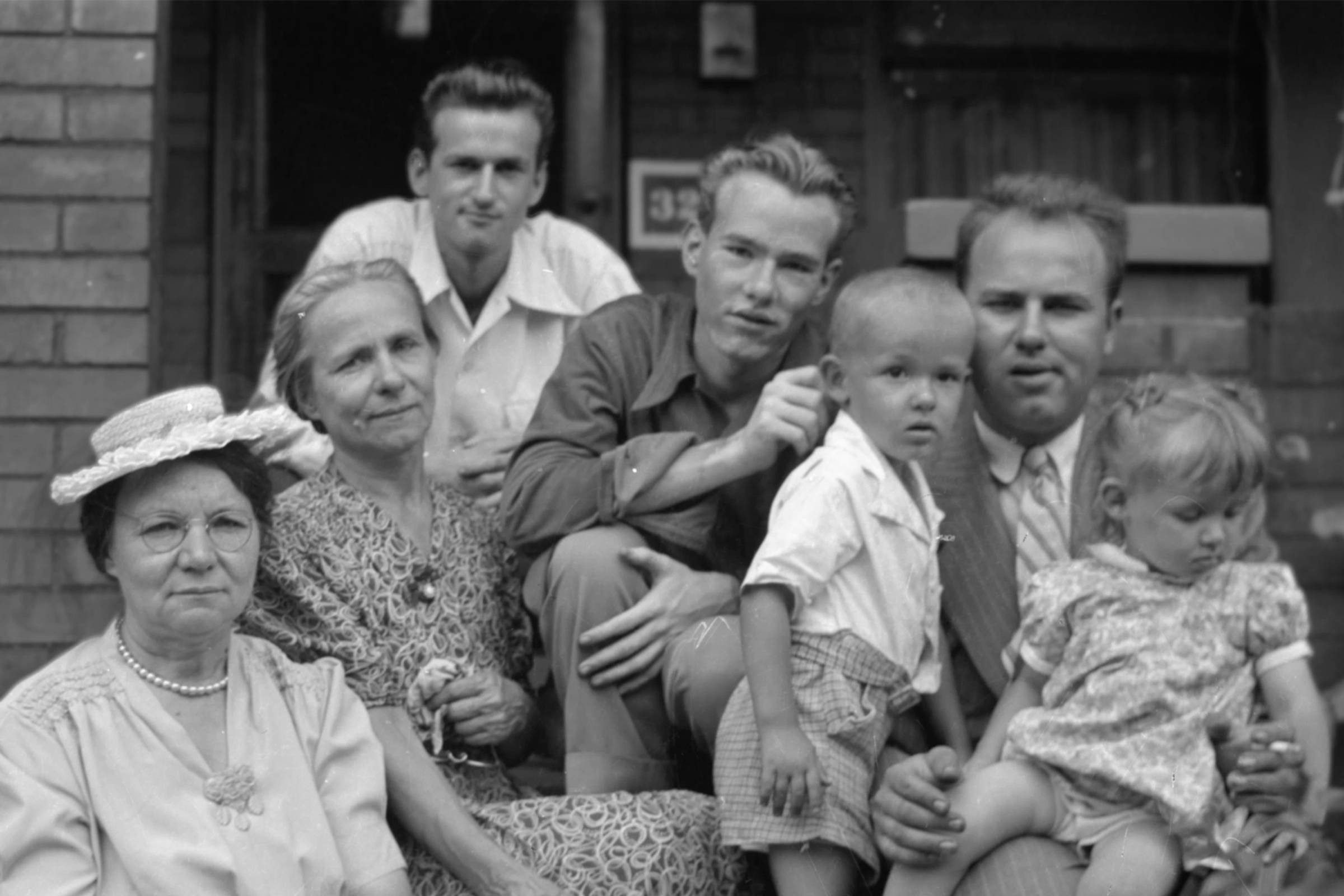 Teenage Warhol (center) surrounded by his family, 1940s