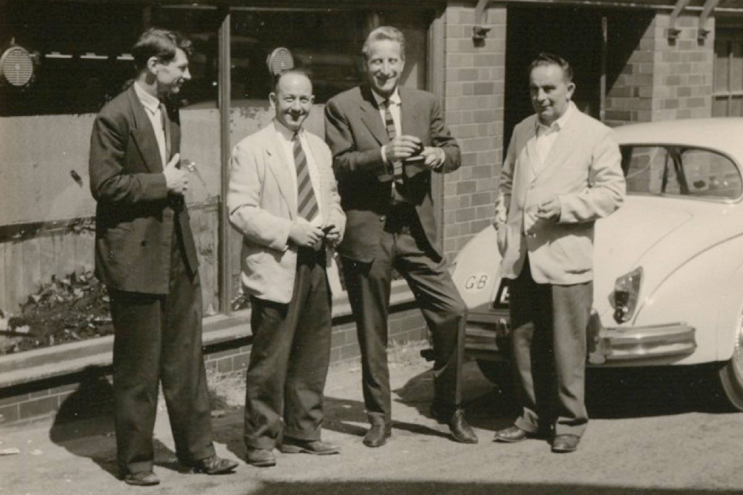 Dr. Klaus Maertens (second from right) outside R. Griggs & Co. LTD.