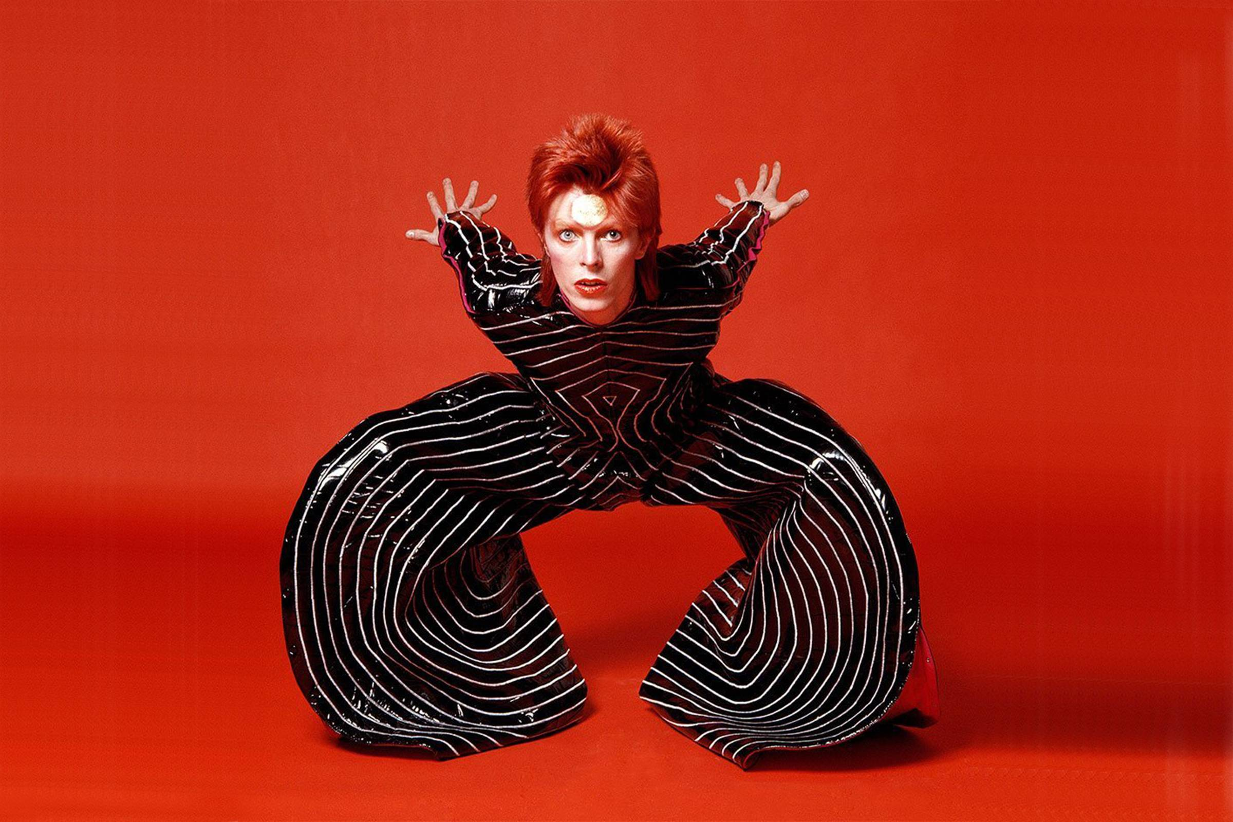 David Bowie as Ziggy Stardust in a striped baloon jumpsuit by Kansai Yamamoto