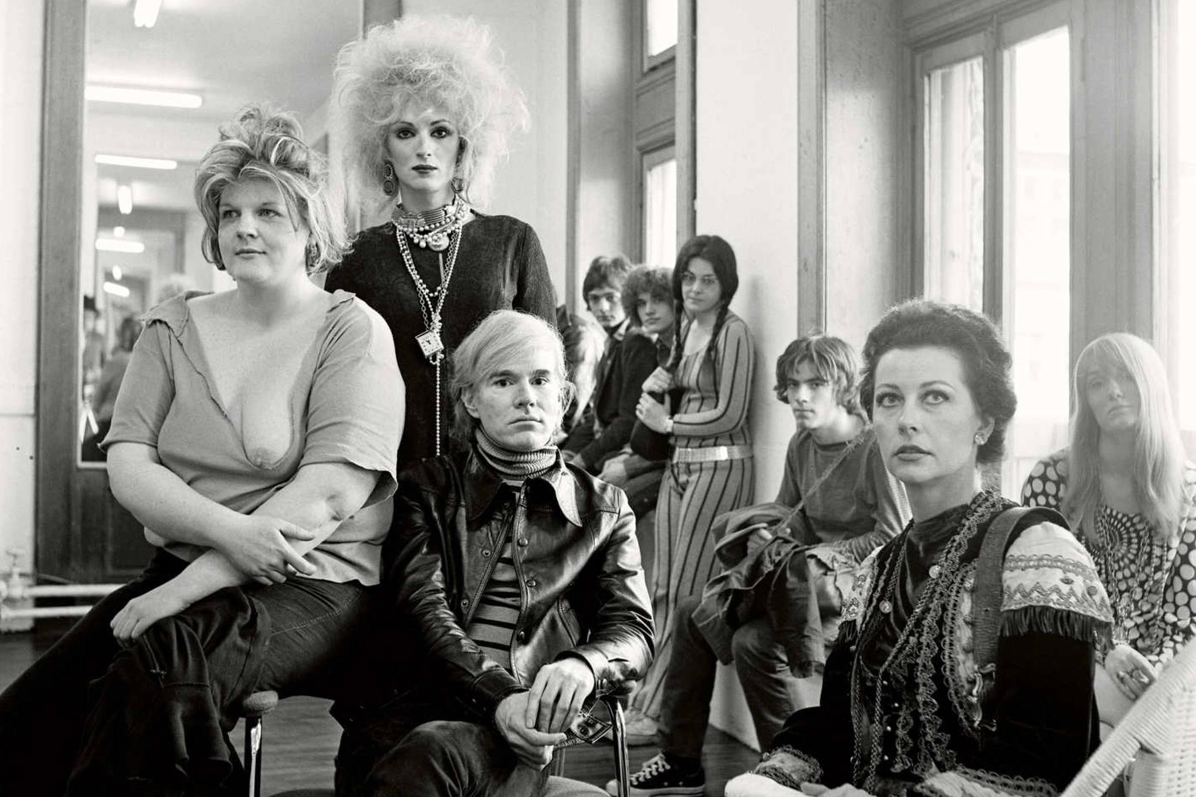 Warhol surrounded by muses at the Factory, 1960s
