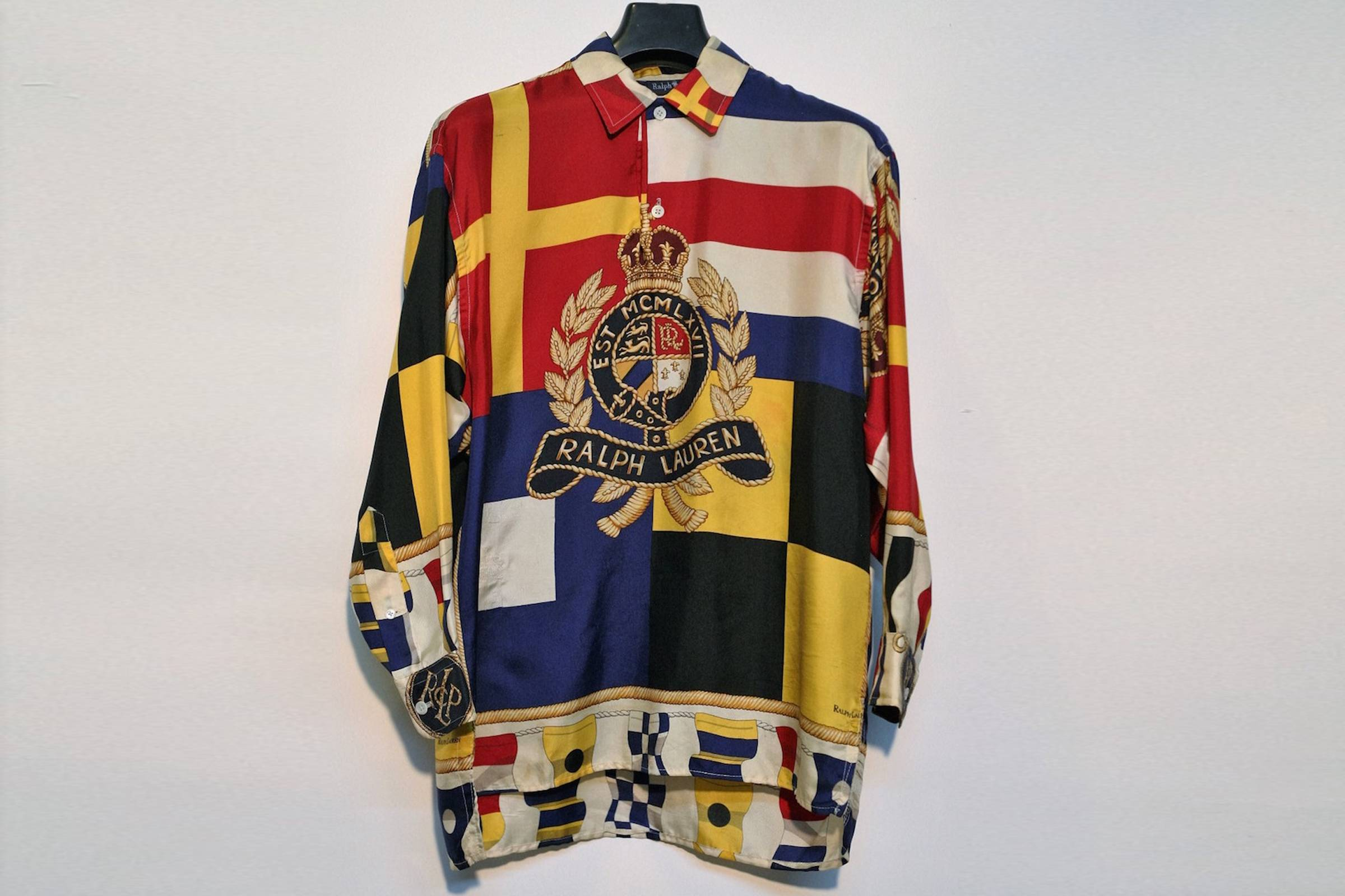 32ee9995a The silk crest shirt represents a significant phase in Ralph Lauren's  history. Originally a women's only piece, its loud design—featuring sailing  flags, ...