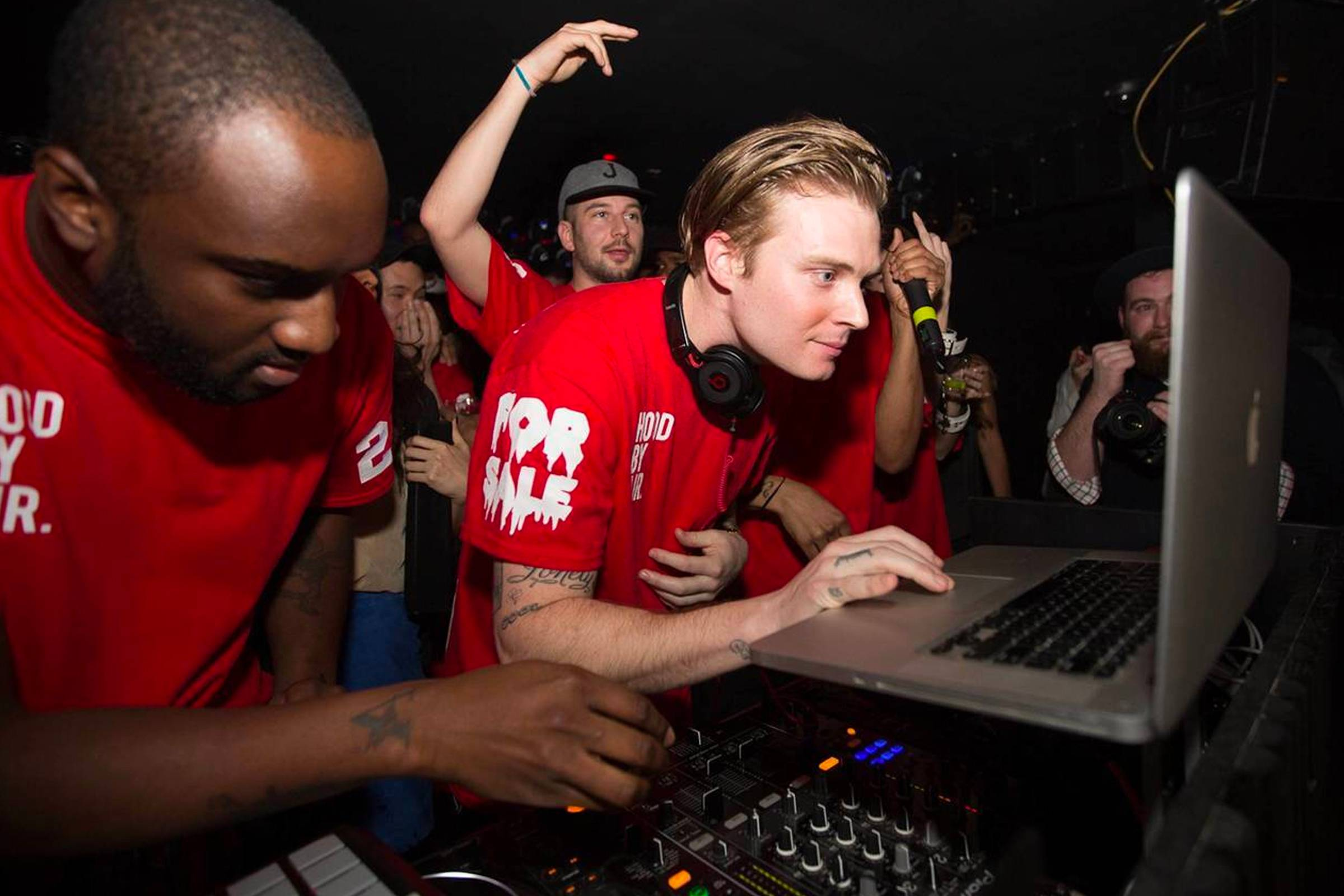 Virgil Abloh (left) DJing with Justin Saunders (back, center) and Matthew Williams (front, center) as the #BEENTRILL# collective