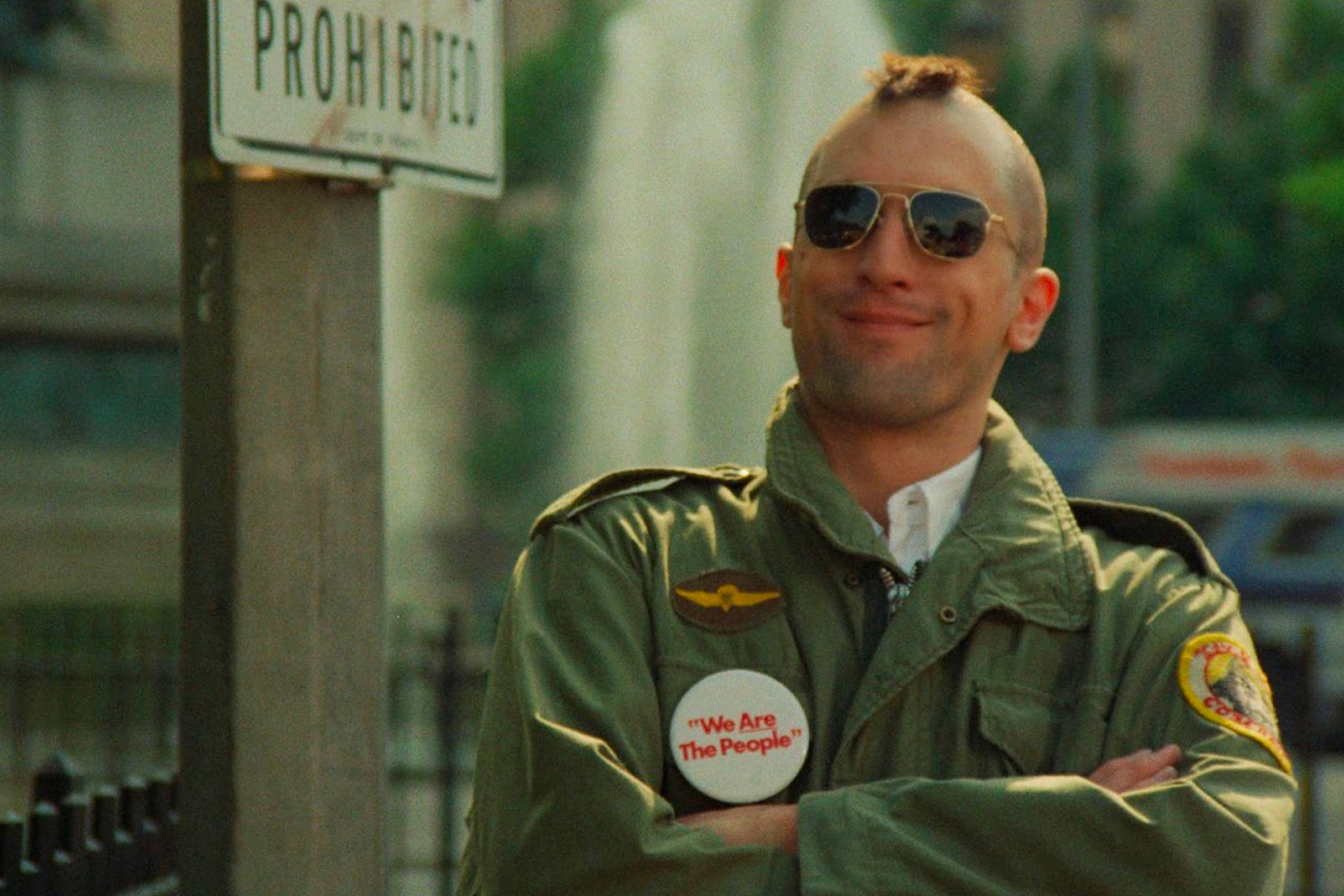 "Robert DeNiro as Vietnam War veteran Travis Bickle in ""Taxi Driver"". Bickle technically wears Ray-Ban Caravan sunglasses, a squared-off version of the aviator silhouette"