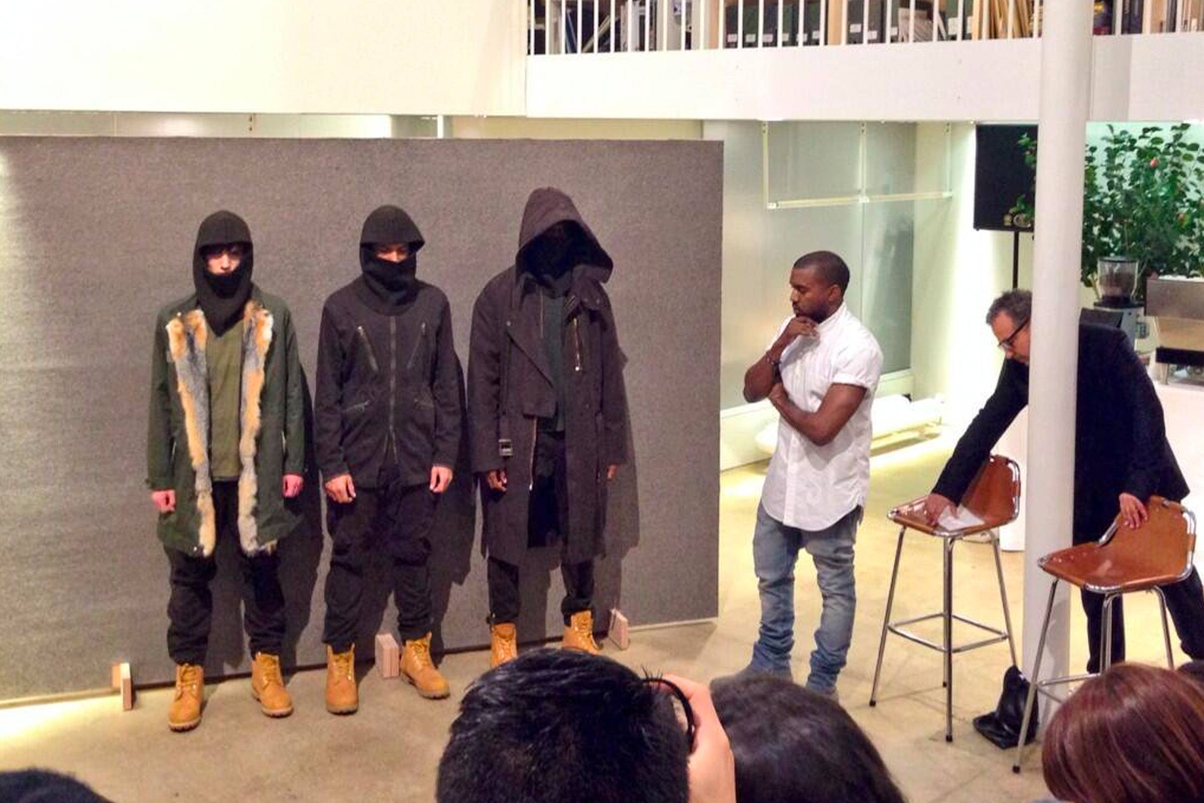 Kanye West explaining his concepts and presenting pieces from his second A.P.C. collaboration collection for Fall/Winter 2014
