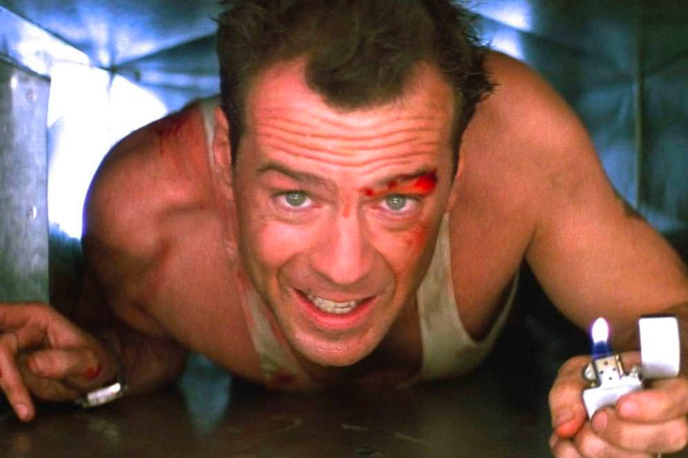 "Bruce Willis portraying John McClane using his Zippo in ""Die Hard"""
