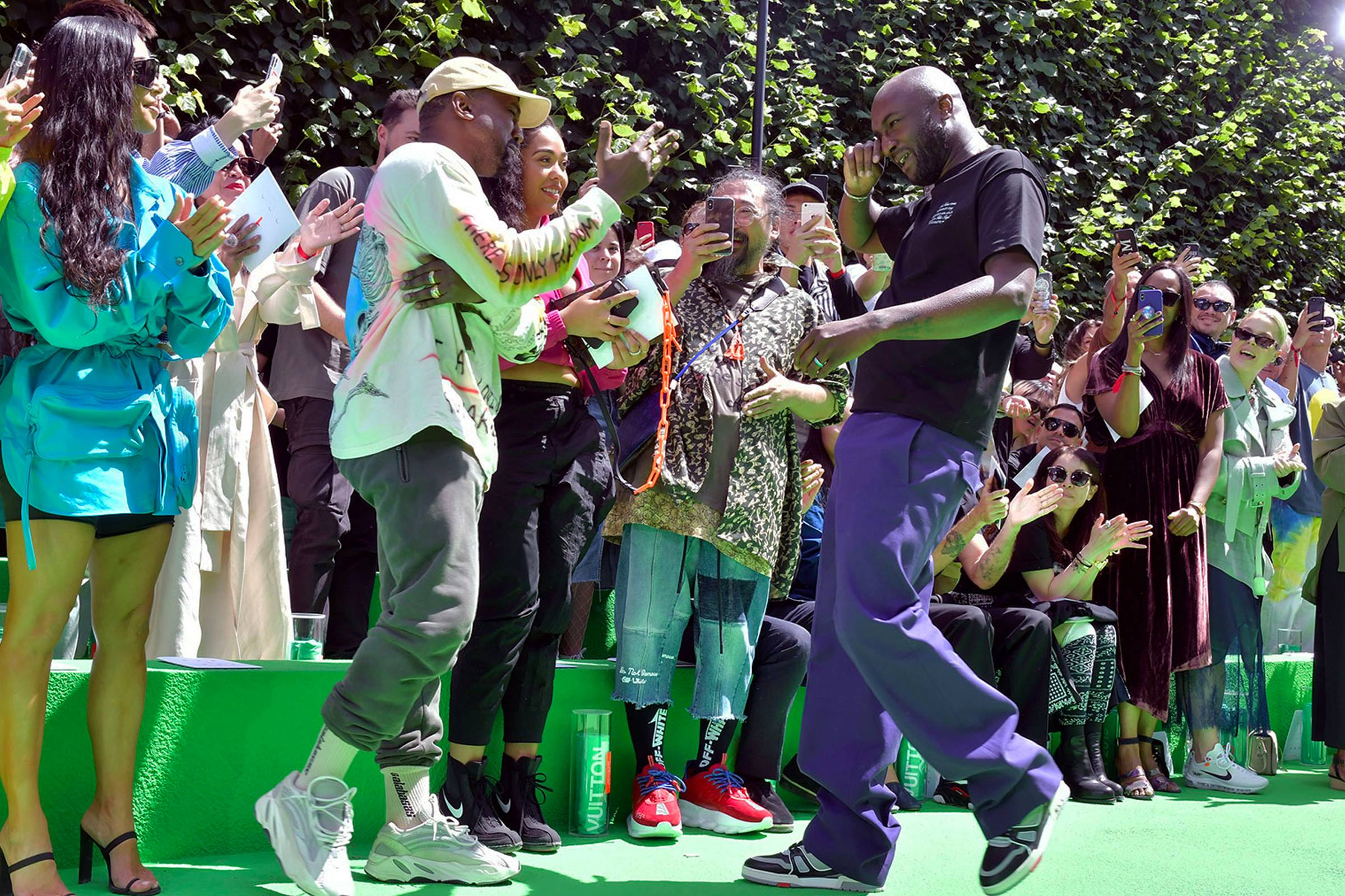 Virgil Abloh and Kanye West during the finale of Abloh's debut Spring/Summer 2019 Louis Vuitton menswear show