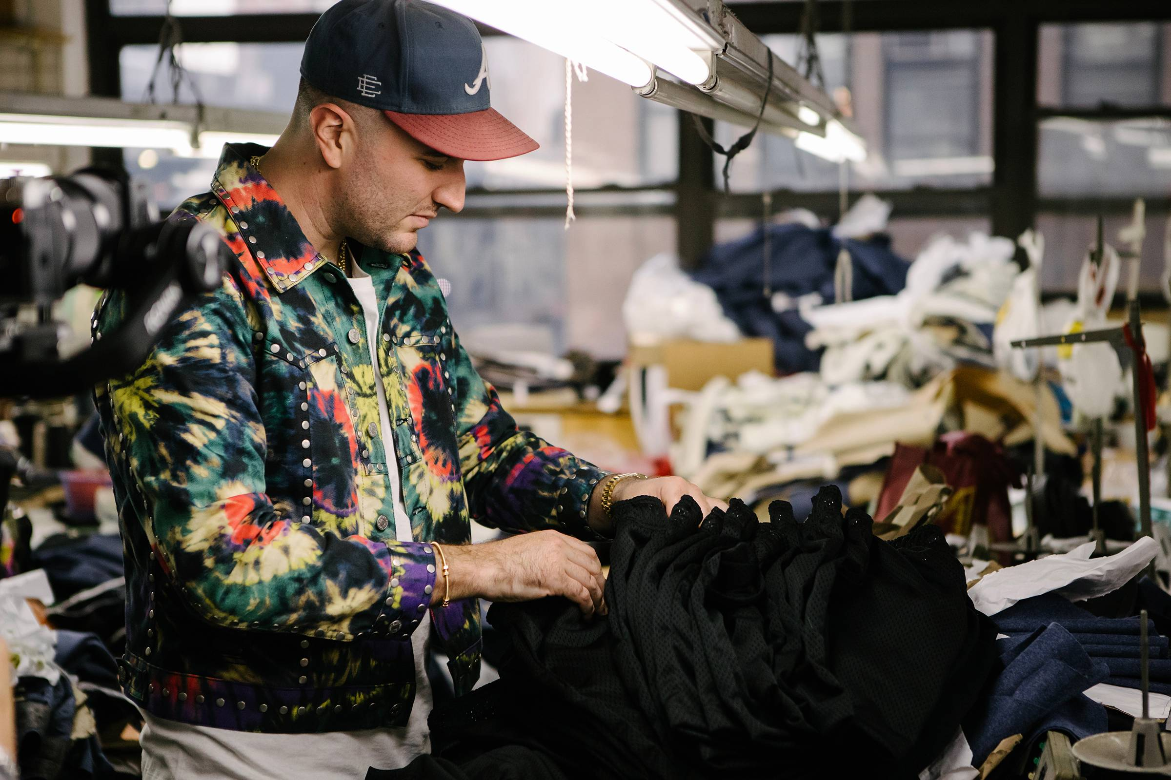 Eric Emanuel looking through product at the factory in New York City