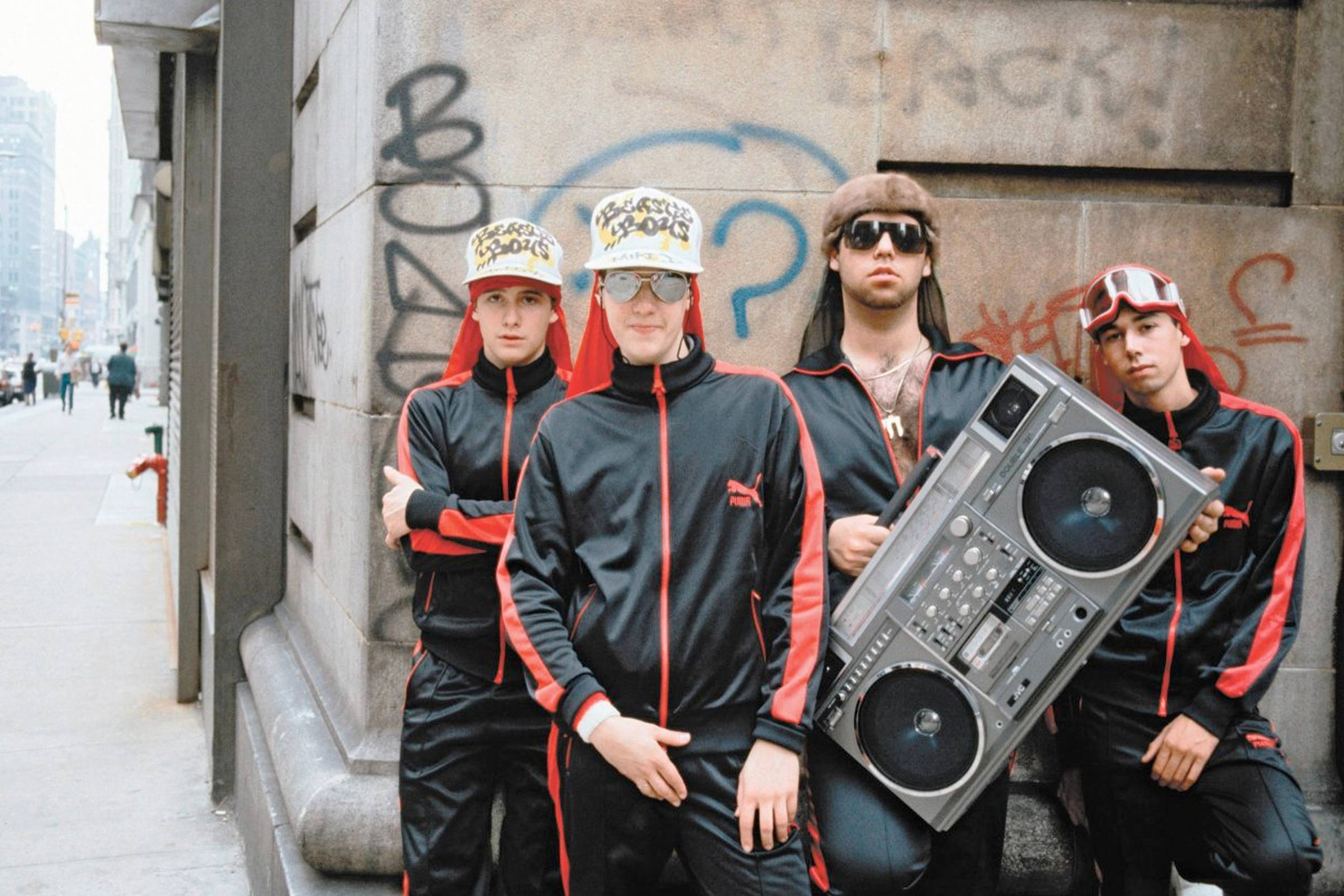 The Beastie Boys in Puma tracksuits with Rick Rubin (holding boombox)