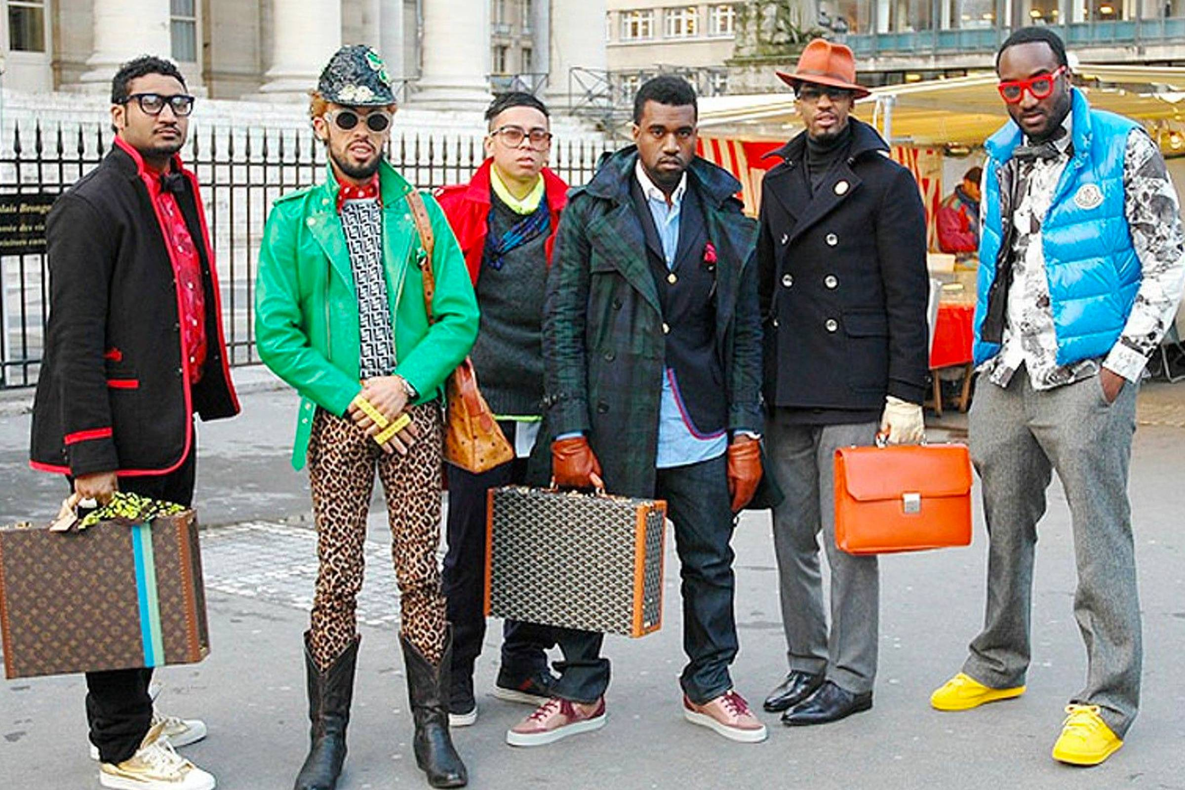 Kanye West holds a Goyard briefcase at the center of this infamous street style photo, shot by Tommy Ton in 2009