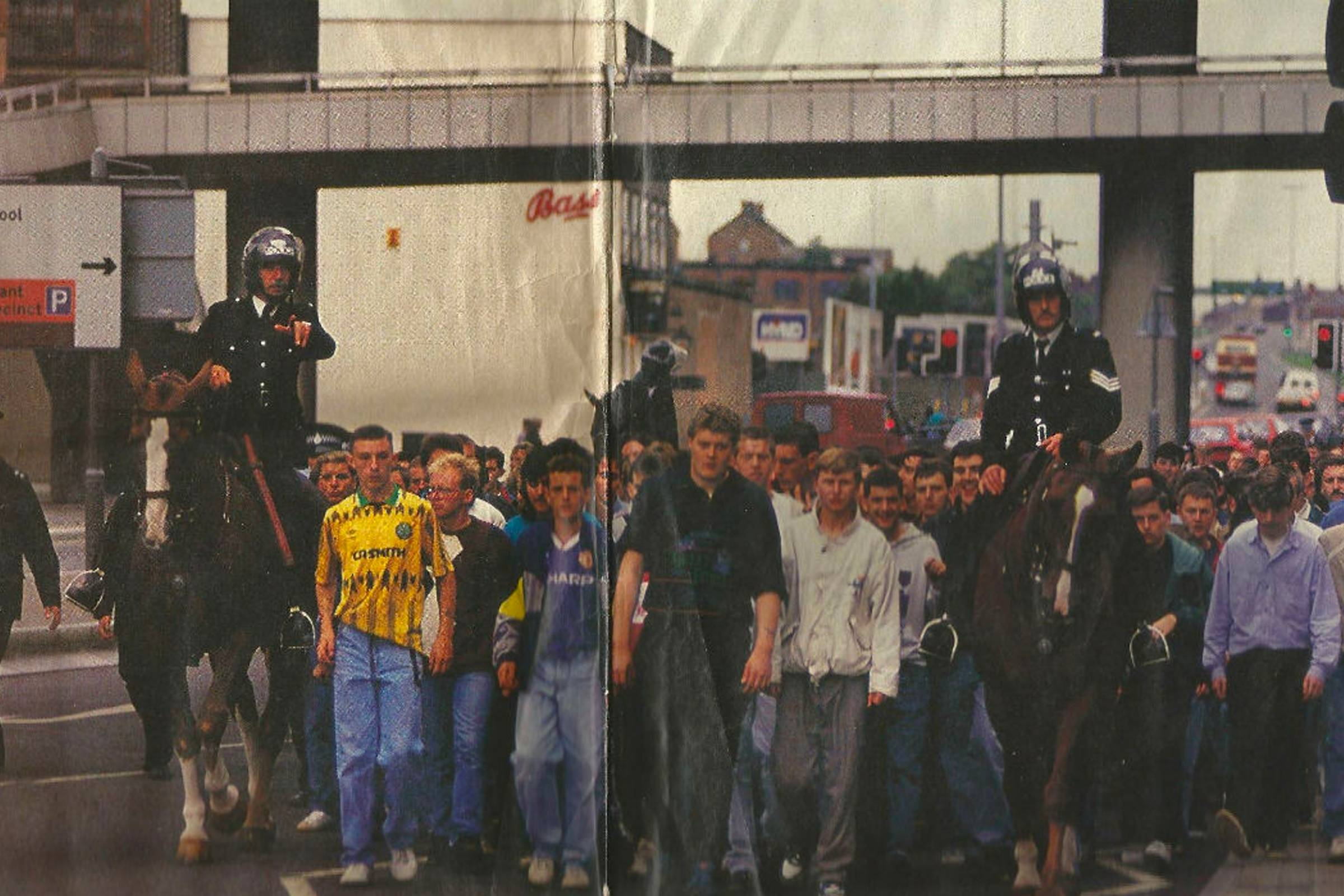 A crowd corralled by police during a Manchester United match at Everton sometime in the 1990s
