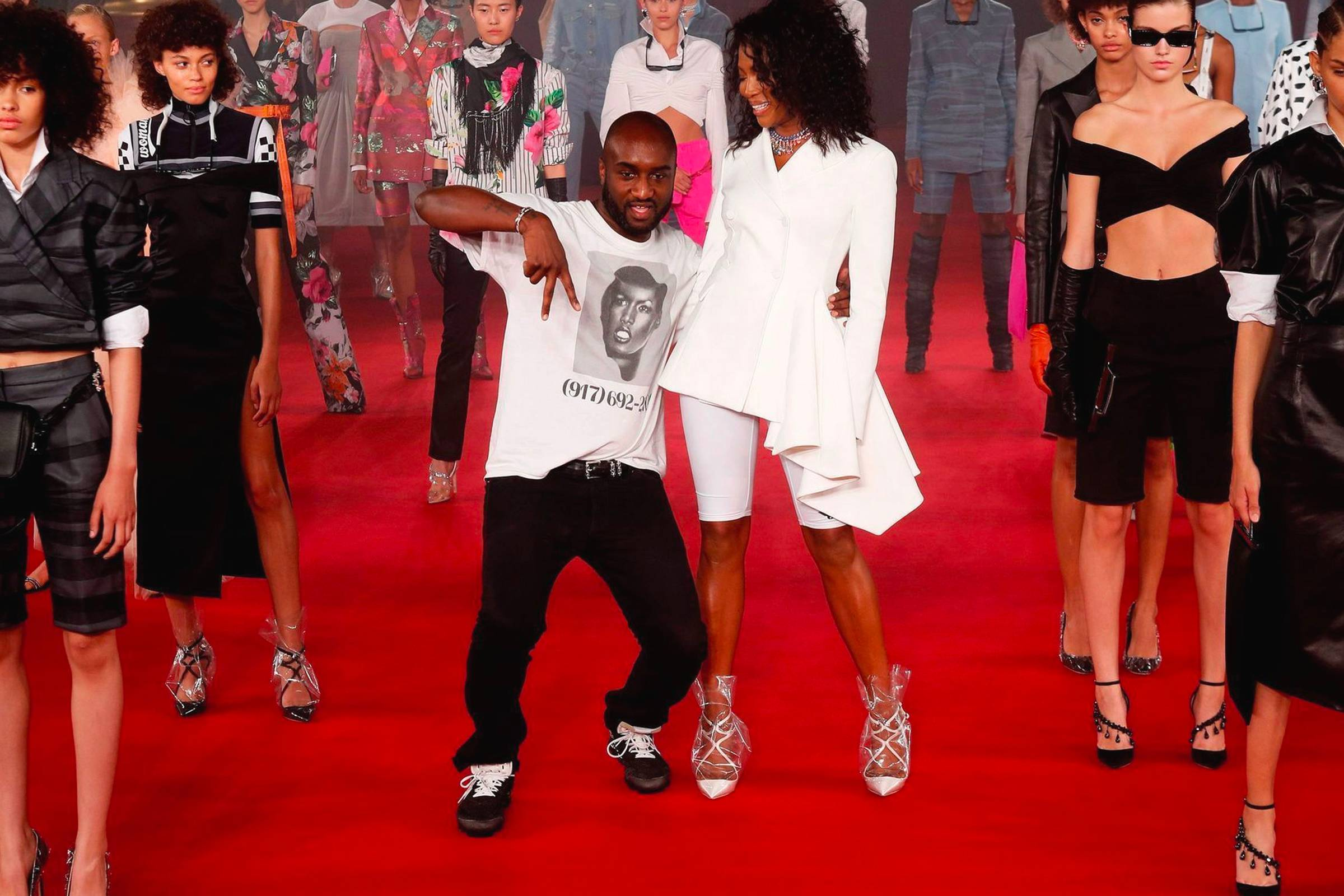 Abloh with Naomi Campbell at the close of Off-White Spring/Summer 2018
