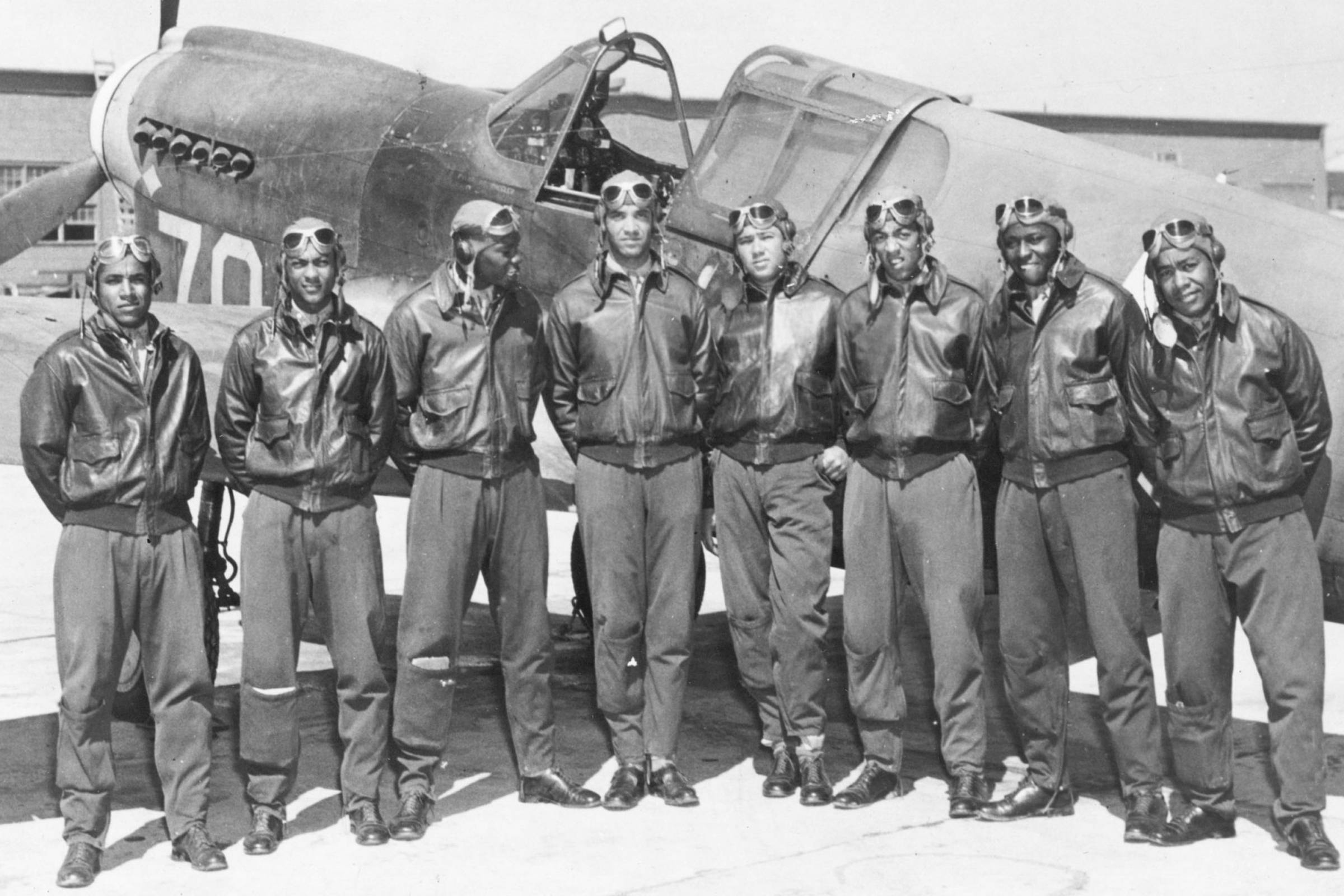 Tuskegee Airmen in A-2-style flight jackets
