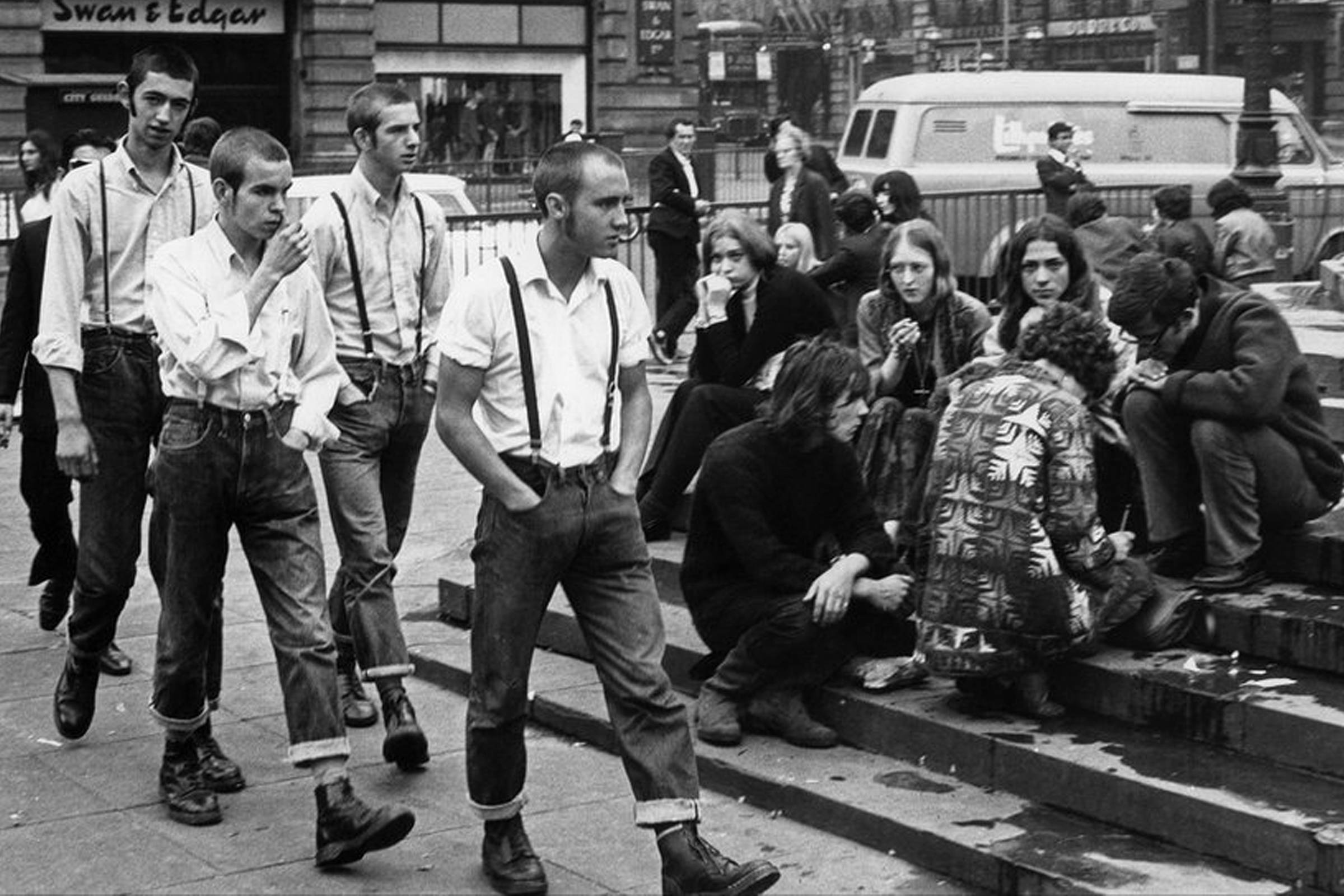 """On the Steps of Eros"" photographed by Terry Spencer; Skinheads and hippies sharing space in London's Piccadilly Circus in 1969"