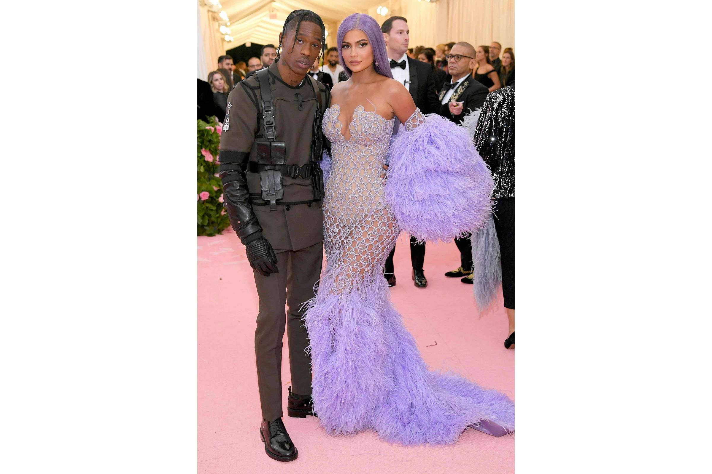 Travis Scott (in Dior Homme) and Kylie Jenner (in Versace)