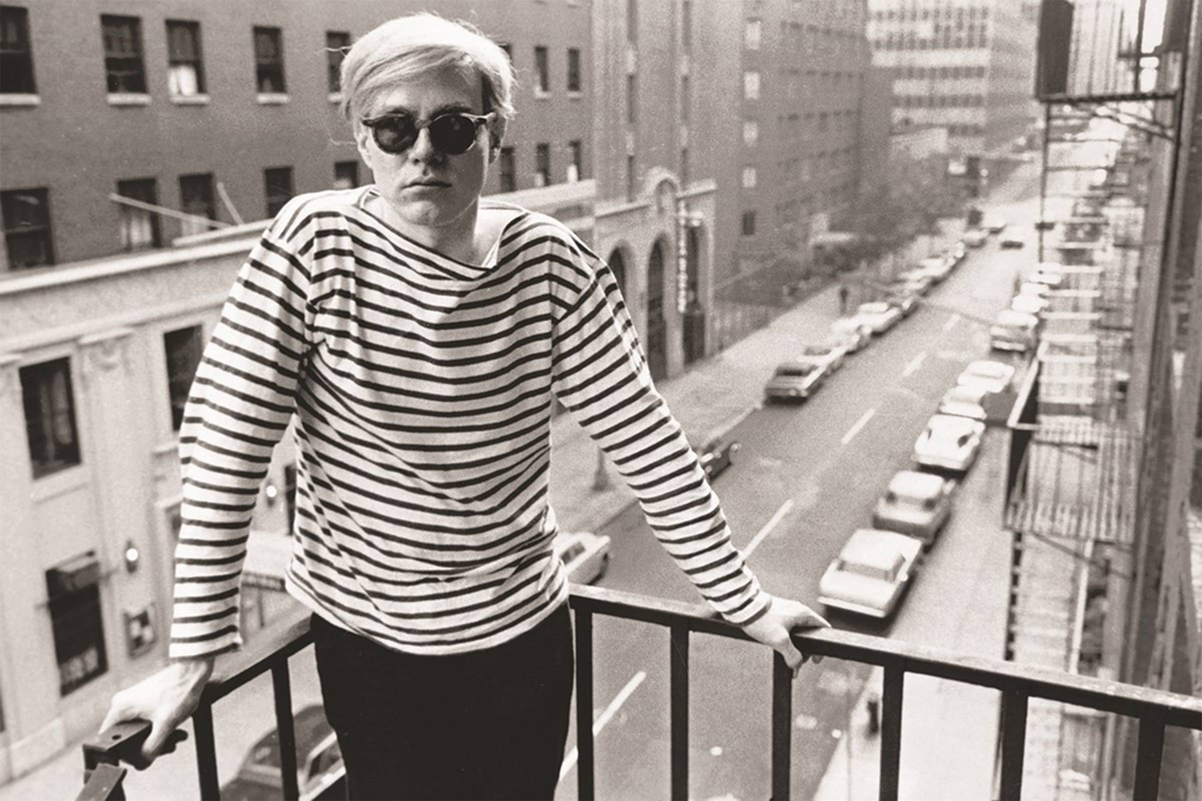 Warhol in his signature Moscot frames