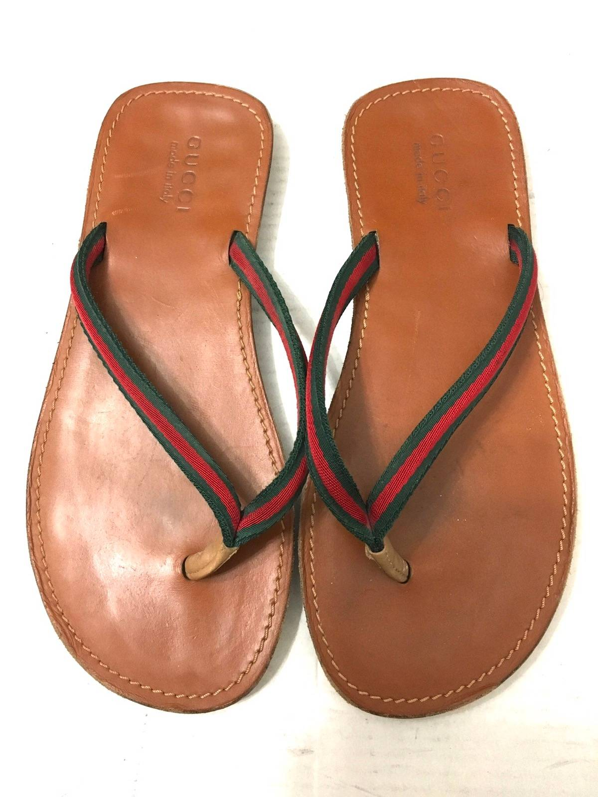 ae21b9745 Gucci ×. Gucci Brown Leather Thong Sandals
