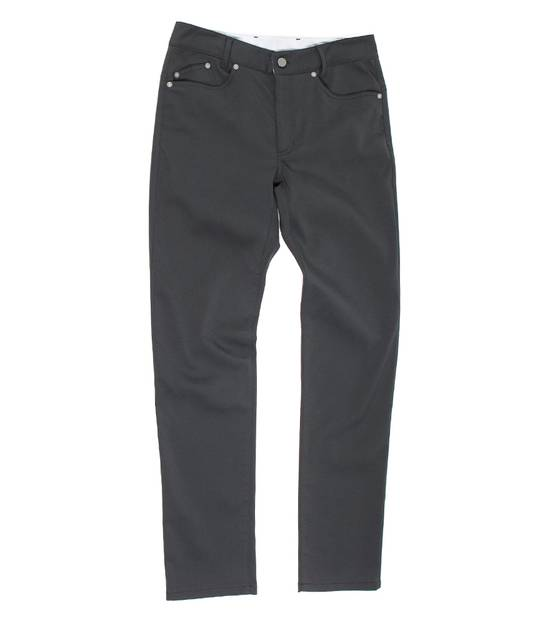 Used pair of 60/30 outlier pants. 2 tiny stains on the right thigh area in the front of the pants. The chino — upgraded. Invisible technology in action. Structure, stretch and snap that must be worn to comprehend.