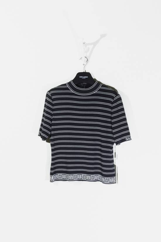 "Balmain Brand new tee with short sleeves, back neck zip closure and woven patterns in a black & grey striped colorway from Balmain Paris, size is marked as ""40"" Size US XXS / EU 40"