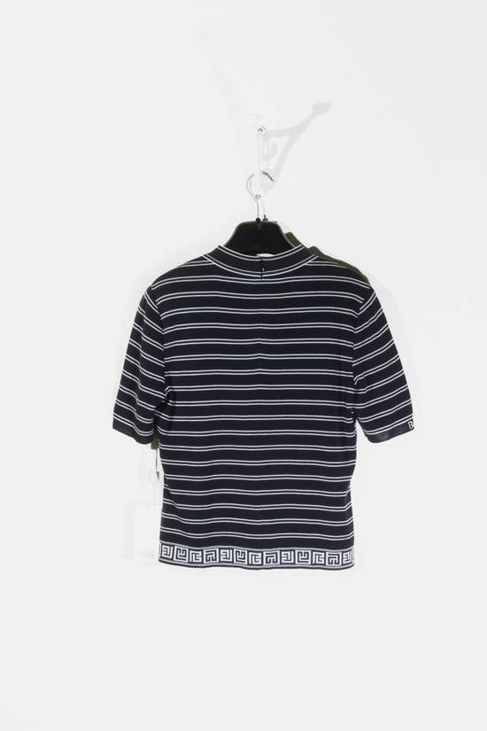 "Balmain Brand new tee with short sleeves, back neck zip closure and woven patterns in a black & grey striped colorway from Balmain Paris, size is marked as ""40"" Size US XXS / EU 40 - 1"